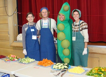Food Workers in Apron and One Dressed as a Pea